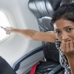 Woman Pointing out Problem with Aircraft